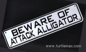"""Beware of Attack Alligator"" Sign"